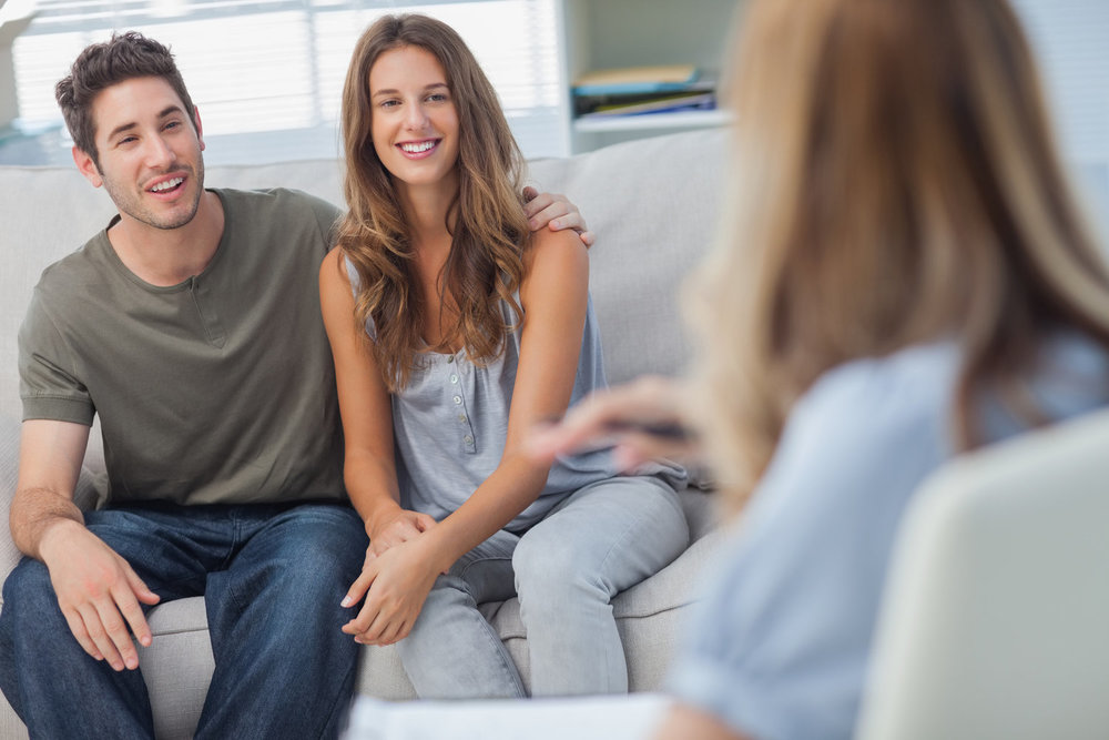 Couple happy during psychotherapy behavioral health clinic